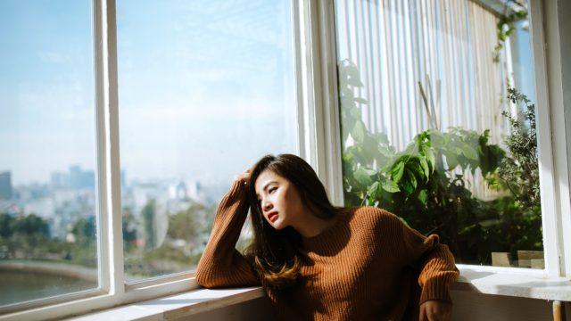 women is near the window